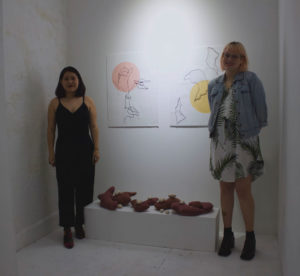 photograph of two artists in the gallery